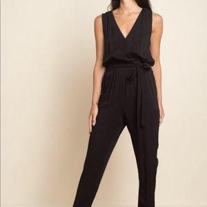 NWT Black Jump Suit. Adjustable Tie.